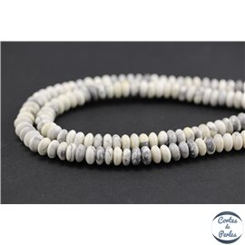 Perles semi précieuses en howlite - Roues/8 mm