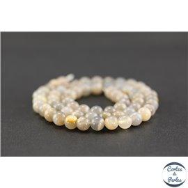 Perles en pierre de soleil noire - Rondes/6.5mm
