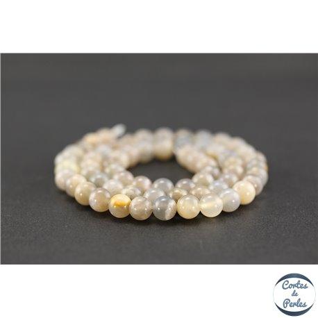 Perles semi précieuses en pierre de soleil noire - Ronde/6,5 mm
