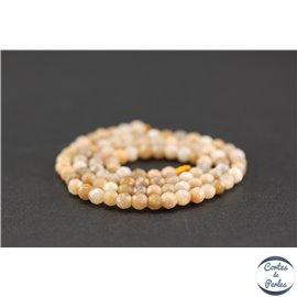 Perles semi précieuses en pierre de soleil - Ronde/4 mm