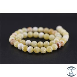 Perles en honey jade - Rondes/8mm