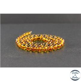 Perles en ambre miel de la Baltique - Rondes/7mm - Grade A