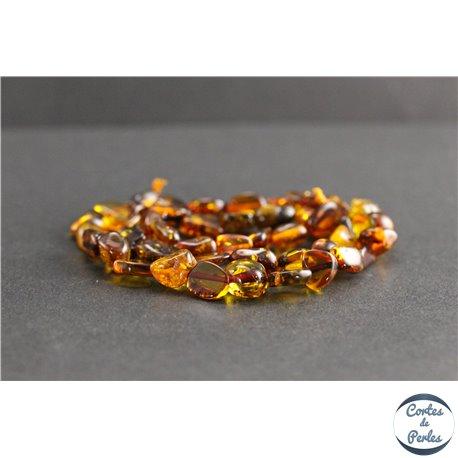 Perles en ambre cognac de la Baltique - Nuggets/9mm - Grade AB