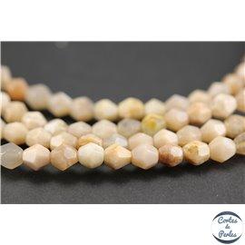 Perles semi précieuses en pierre de soleil - Toupies/6 mm - Rose saumon