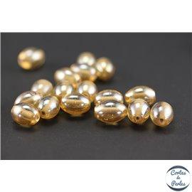 Perles indiennes en verre - Ovales/14 mm - Pêche dorée