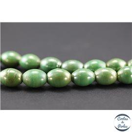 Perles indiennes en verre - Ovales/14 mm - Vert amande